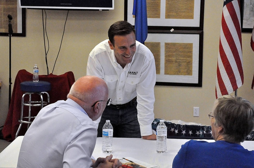 Horace Langford Jr./Pahrump Valley Times - Republican contender for Nevada Governor, Adam Laxalt is pictured discussing topics of interest with Pahrump Valley residents.