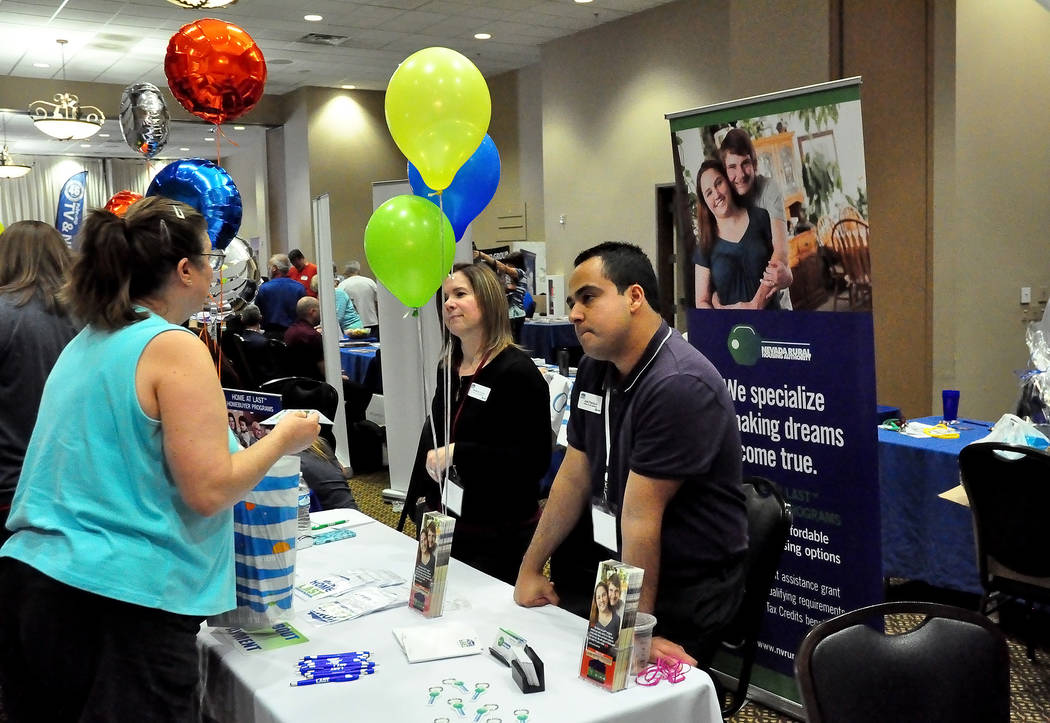 Horace Langford Jr./Pahrump Valley Times This 2016 photo shows representatives from the Nevada Rural Housing Authority talking to a visitor at a booth during the annual Biz and Home Expo at the P ...