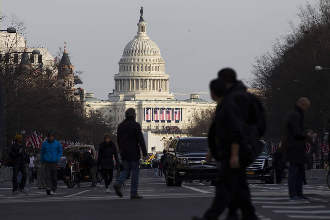 Erik Verduzco/Las Vegas Review-Journal People walk on Pennsylvania Avenue near the U.S. Capitol and along the scheduled presidential inauguration parade route on Thursday, Jan. 19, 2017, in Washin ...