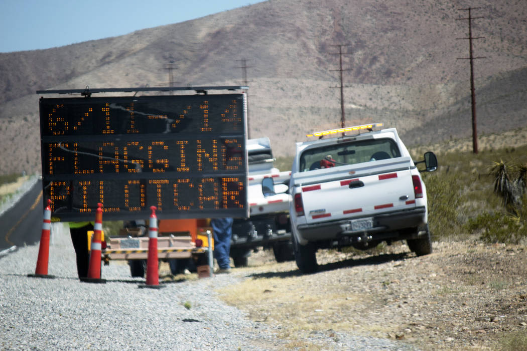 Jeffrey Meehan/Pahrump Valley Times Crews turn on road construction signs to warn motorists of possible delays on Highway 160, north of Pahrump. The northbound and southbound lanes, between mile ...