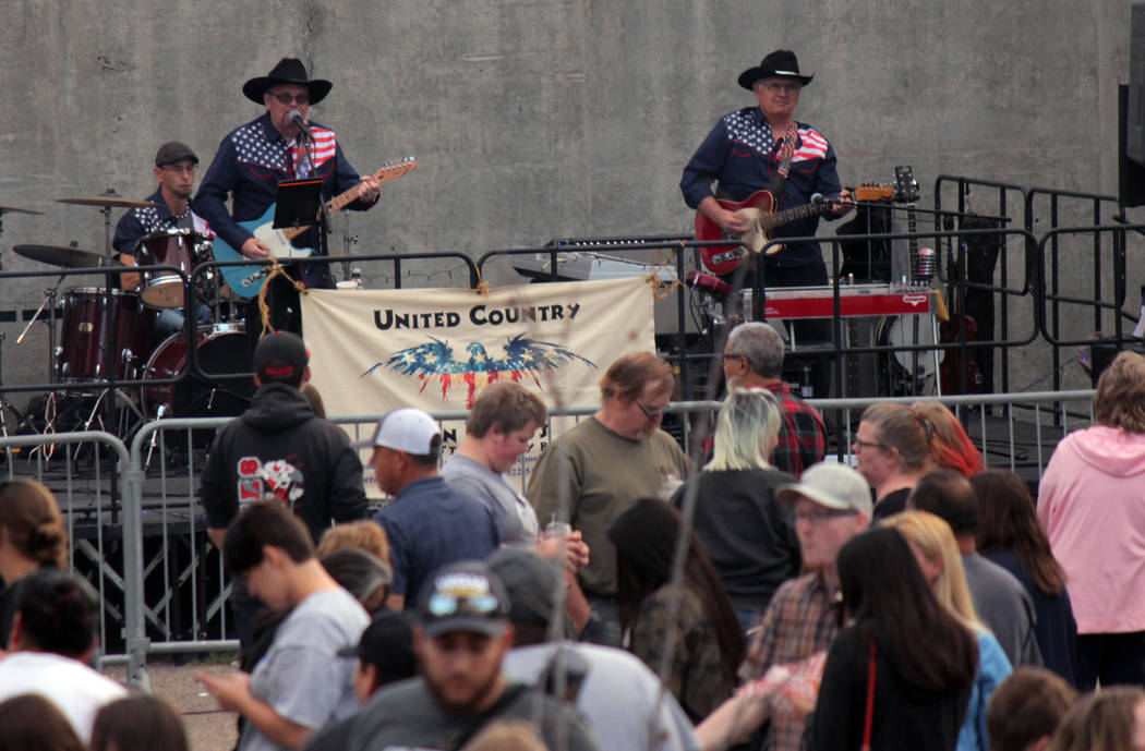 Jeffrey Meehan/Pahrump Valley Times Things heated up along Main Street in Tonopah as the street dance got underway during the Jim Butler Days celebration on May 25, 2018. About 100 people gathered ...