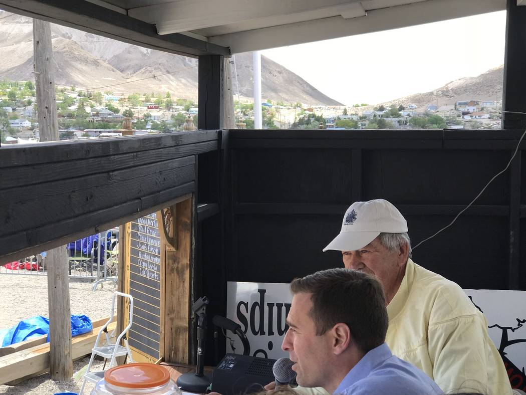 Jeffrey Meehan/Pahrump Valley Times Nevada Attorney General Adam Laxalt (front) speaks at the 2018 Nevada State Mining Championships on May 26, 2018. Laxalt sat next to Clown Motel owner Bob Perch ...