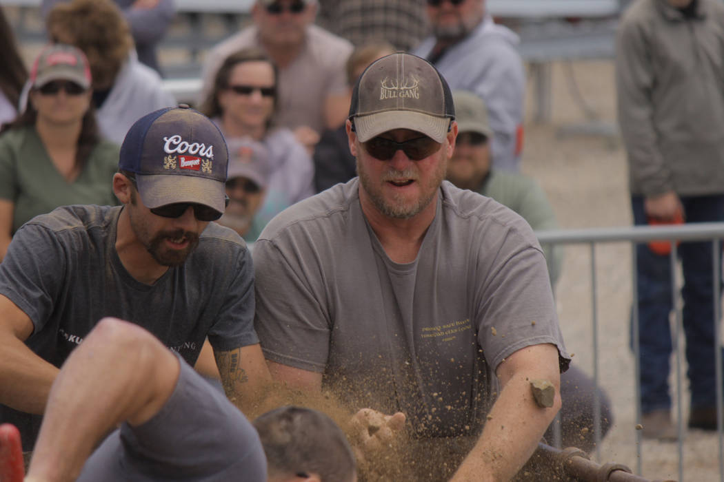 Jeffrey Meehan/Pahrump Valley Times Dirt and rock flies through the air during the men's mucking competition at the 2018 Nevada State Mining Competition. The men's division brought out 10 contesta ...