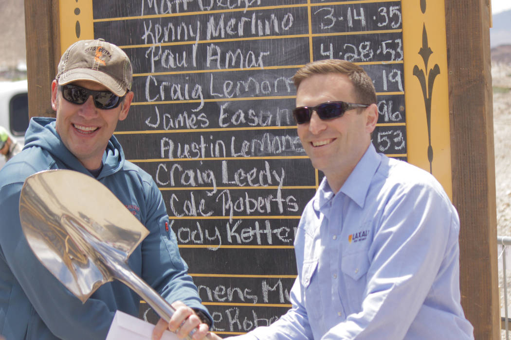Jeffrey Meehan/Pahrump Valley Times Nevada Attorney General Adam Laxalt (right) hands the silver shovel to James Eason, the top winner of the men's mucking competition, on May 26, 2018 at the Tono ...