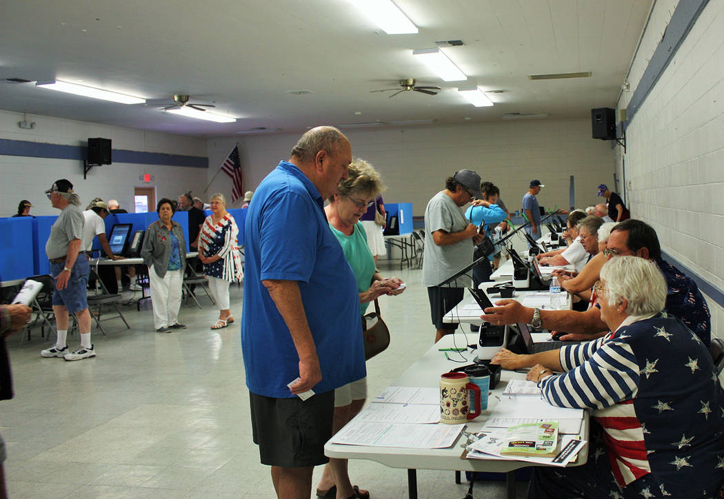 Robin Hebrock/Pahrump Valley Times The Bob Ruud Community Center was bustling with activity on Tuesdaym June 12 as Nye County residents cast their ballots in the 2018 Primary Election. Friendly vo ...