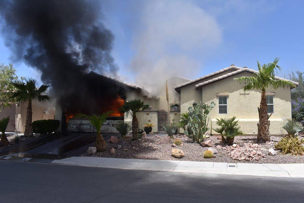 Special to the Pahrump Valley Times A fully-involved structure fire destroyed an attached garage and vehicle along the 5200 block of Agio Avenue in the Mountain Falls community on Monday June 11. ...