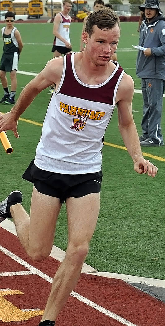 Horace Langford Jr./Pahrump Valley Times Bryce Odegard prepares to receive the baton during the 4 x 800 relay at a weekday meet March 21 at Pahrump Valley High School.