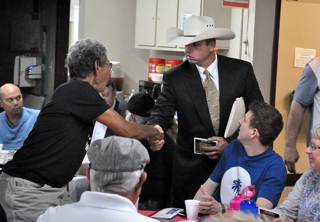 Horace Langford Jr./Pahrump Valley Times Ryan Bundy (right), candidate in the 2018 Nevada governor's race, shakes hands with attendees of an event put on by the Dennis Hof campaign on May 11, 201 ...