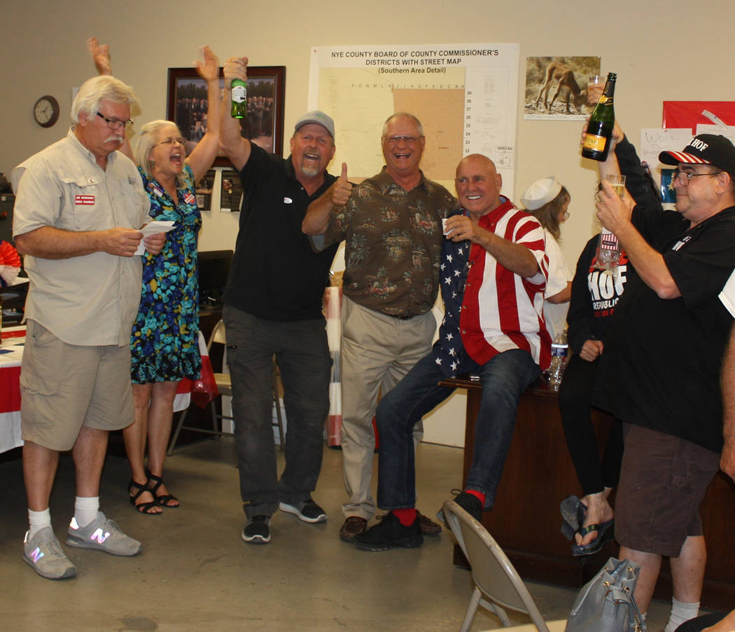 Special to the Pahrump Valley Times Dennis Hof, fifth from the left, secured the Republican nomination for the Nevada Assembly District 36 seat on Tuesday night while Debra Strickland, second from ...