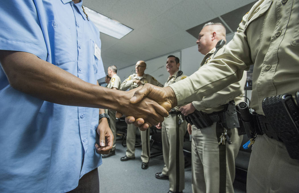 Jeff Scheid/Las Vegas Review-Journal A former inmate shakes hands with Las Vegas police officers during a pre-vocational leadership workshop at Hope for Prisoners, 3430 E. Flamingo Road, on Thursd ...