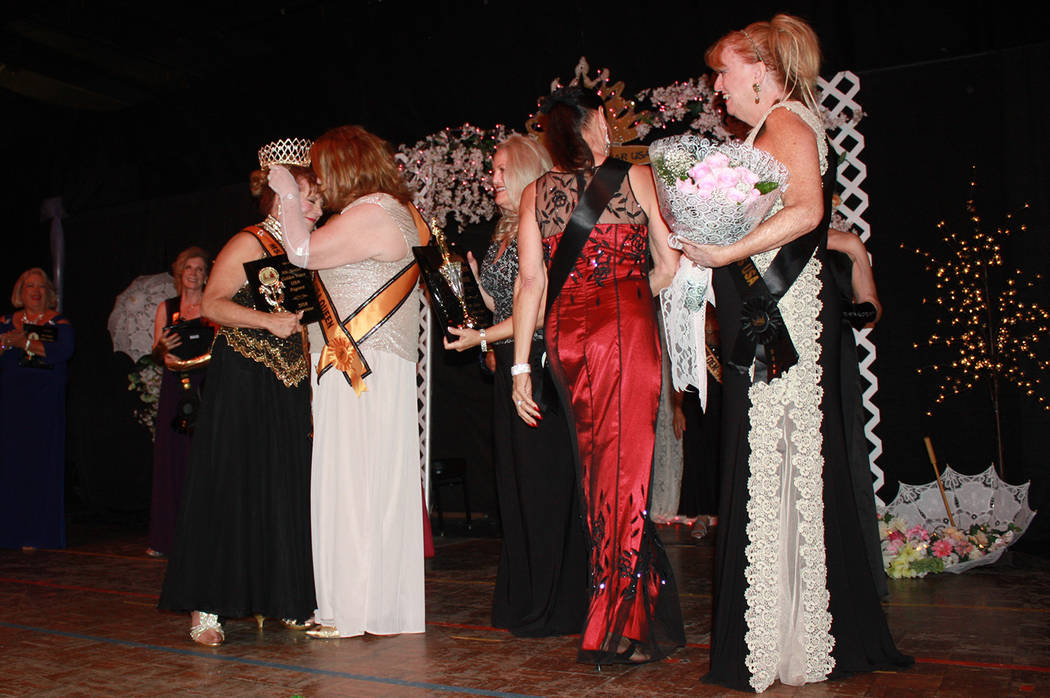 Robin Hebrock/Pahrump Valley Times 2017 Ms. Senior Golden Years Queen Maryellen Swarowski is pictured congratulating her successor, Teri Rogers, at the June 9 pageant.