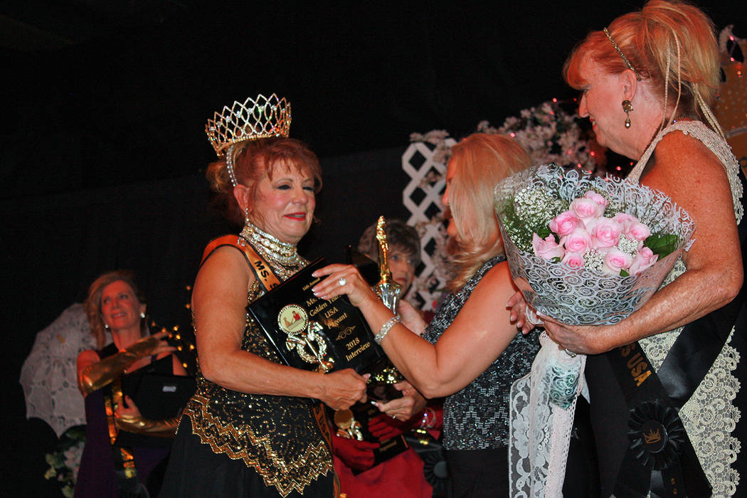 Robin Hebrock/Pahrump Valley Times Teri Rogers was overcome with emotion as she received the crown, sash and plaques marking her success in the Ms. Senior Golden Years USA Pageant.