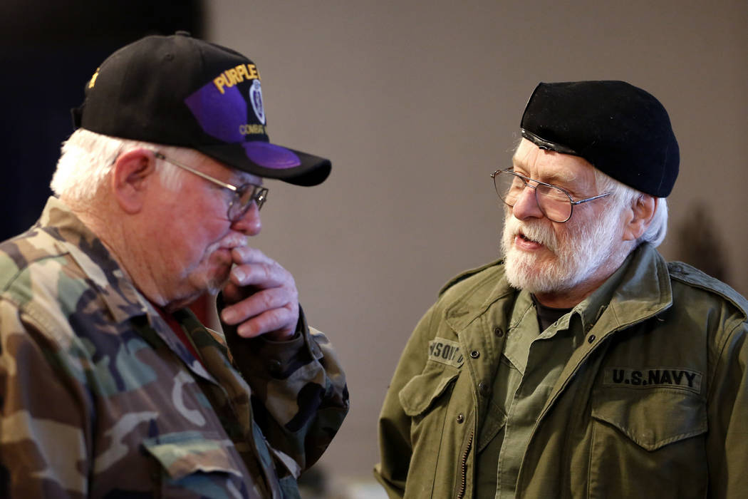 Andrea Cornejo/Las Vegas Review-Journal Veterans Bob Haygood, left, and Dean Johnson exchange war stories during a 50th-anniversary event remembering the Vietnam War Tet Offensive at the American ...