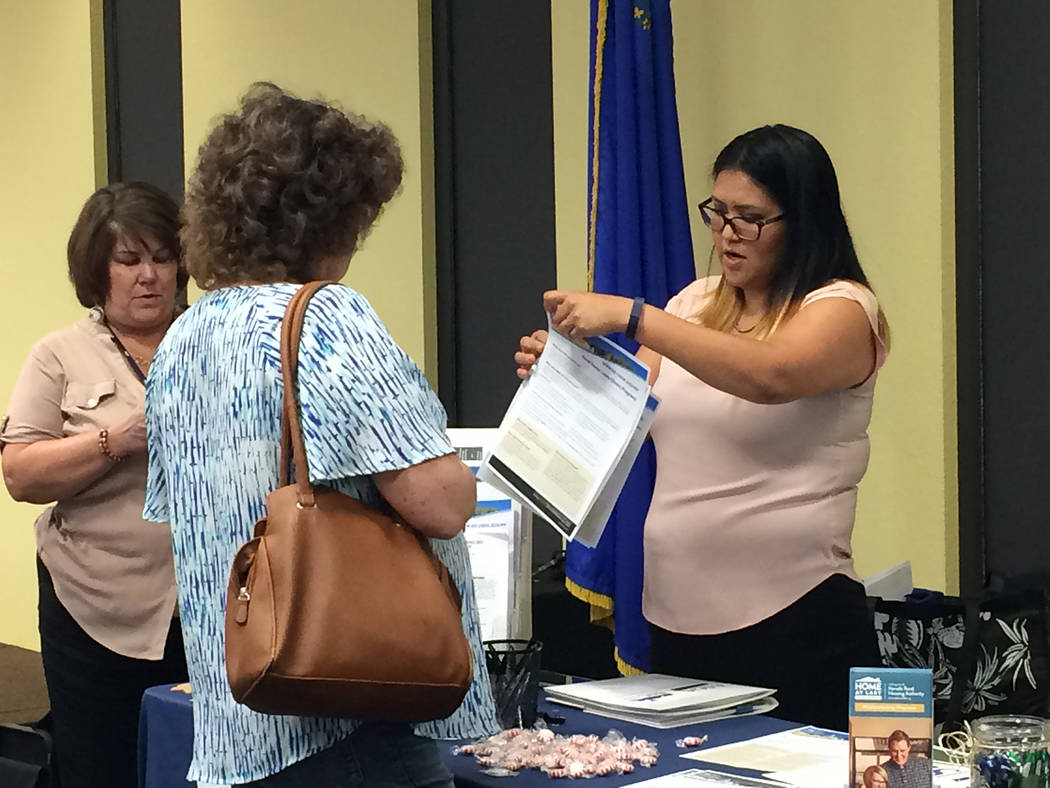 Robin Hebrock/Pahrump Valley Times USDA Single-family Housing Technician Michelle Joe is pictured giving a Pahrump resident a run-down of the organization's rural housing programs during an event ...