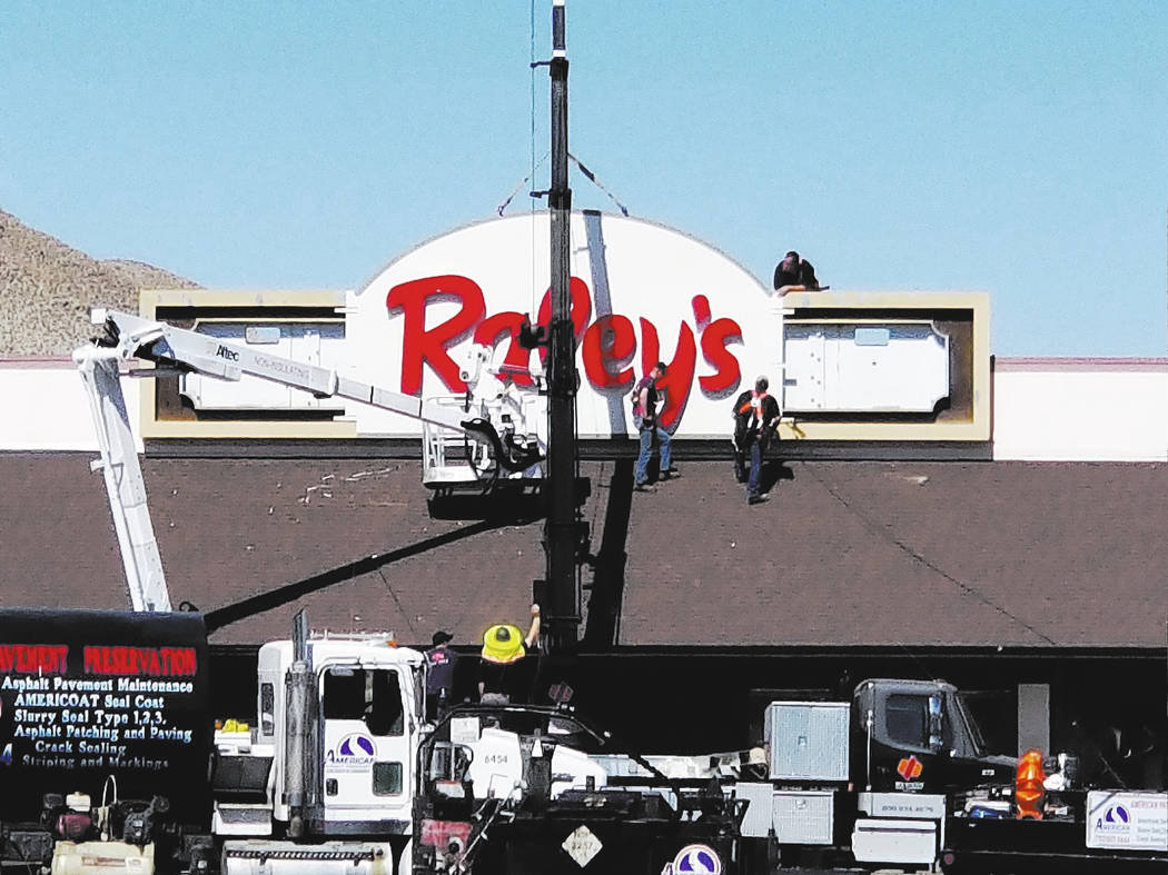 Nancy Whipperman/Pahrump Valley Times The new Raley's sign going up on Tonopah's only grocery store on June 8, 2018. West Sacramento-based Raley's, which purchased the once Scolari's Food & Drug C ...