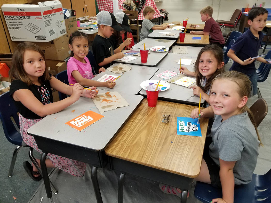Special to the Pahrump Valley Times A group of Pahrump Valley Youth Activities participants create personalized Father's Day cards last week. The popular annual summer program returned to J.G. Joh ...