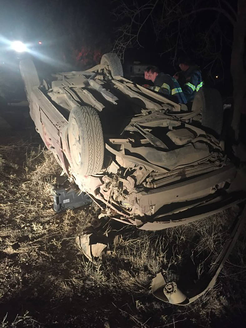 Special to the Pahrump Valley Times Emergency crews were forced to hand carry their equipment more than 25 yards to free an entrapped driver following a rollover crash on the evening of June 11. T ...