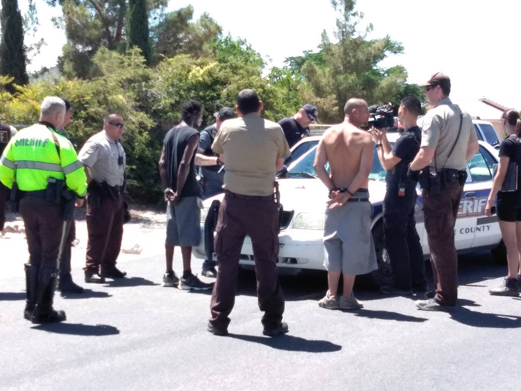 Selwyn Harris/Pahrump Valley Times Two of three suspects are seen detained in handcuffs awaiting transport to the Nye County Detention Center Tuesday afternoon. The trio led sheriff's deputies on ...