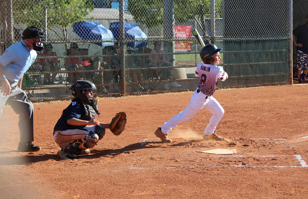 Caroline Thacker/Special to the Pahrump Valley Times P-Town Little League's Ryan Hamlin breaks from the batter's box after making contact against Peccole on Tuesday during the District 4 Tournamen ...