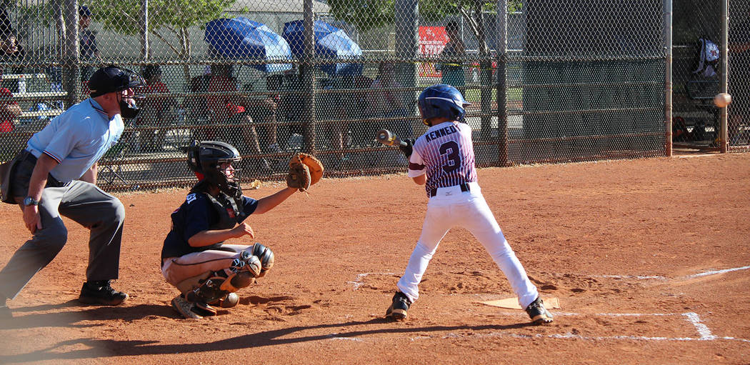 Caroline Thacker/Special to the Pahrump Valley Times Preston Kennedy keeps his eye on the ball during P-Town Little League's game Tuesday against Peccole during the District 4 Little League Tourna ...