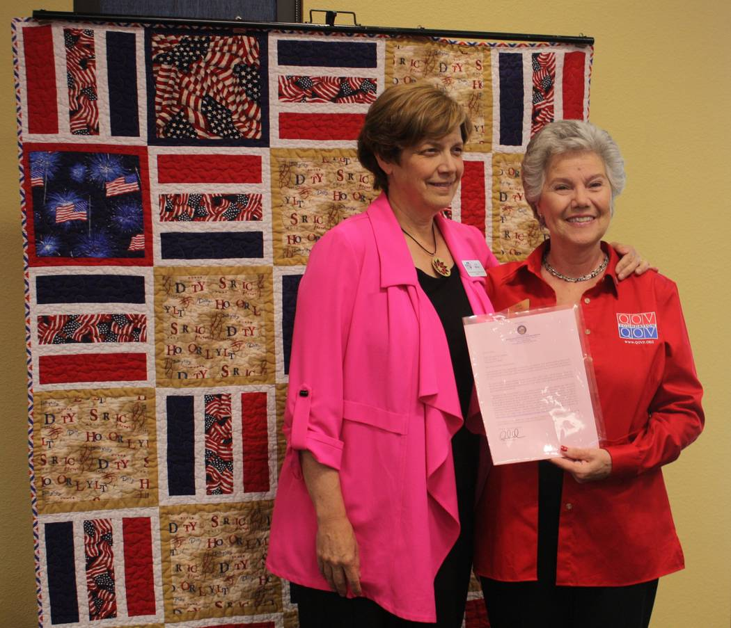 Robin Hebrock/Pahrump Valley Times Nevada Department of Veterans Service Director Katherine Miller, left, posed with Nye County Valor Quilters group leader Elba Rocha following the presentation of ...