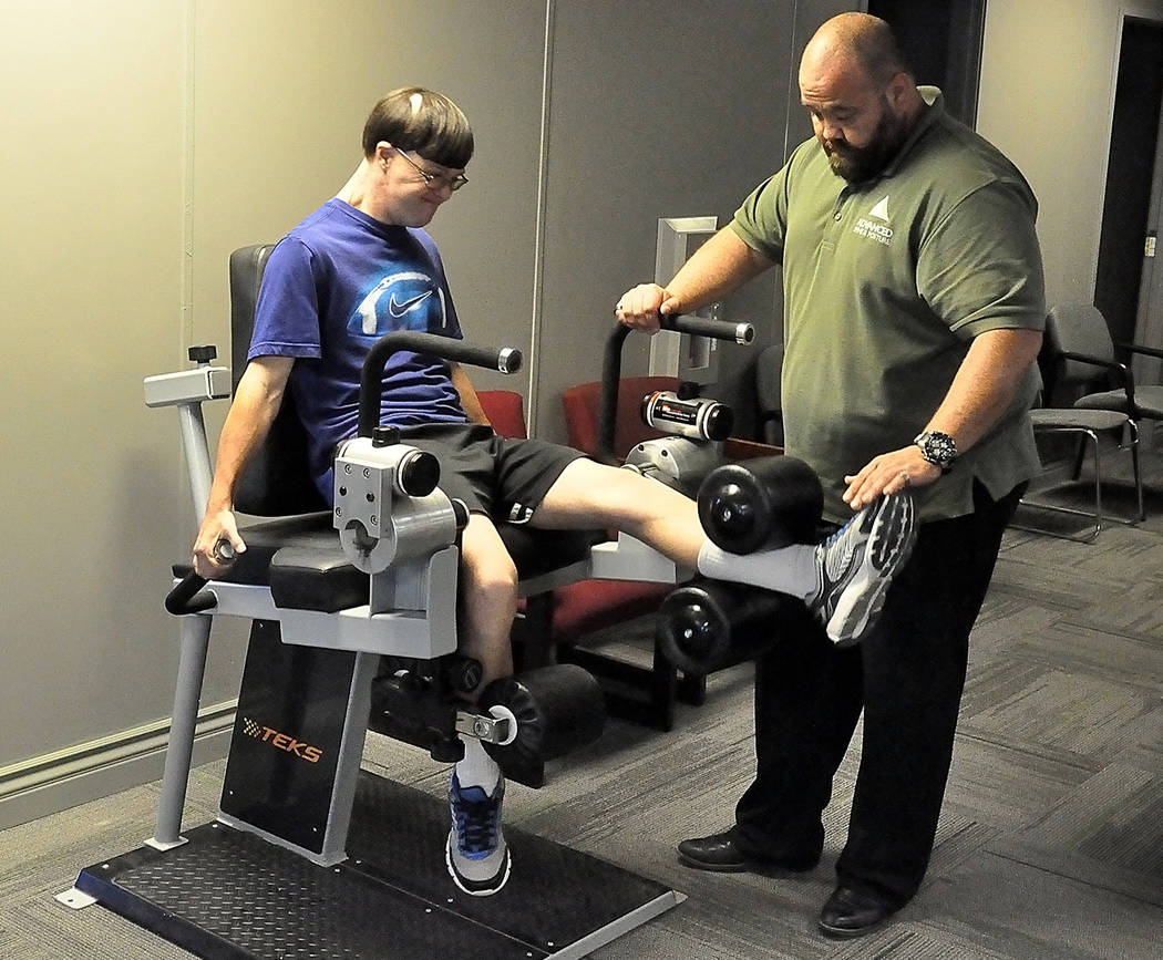 Horace Langford Jr./Pahrump Valley Times Chandy Christensen of Advanced Spine and Posture in Pahrump helps Billy Klem prepare for the 2018 Special Olympics USA Games in Seattle.