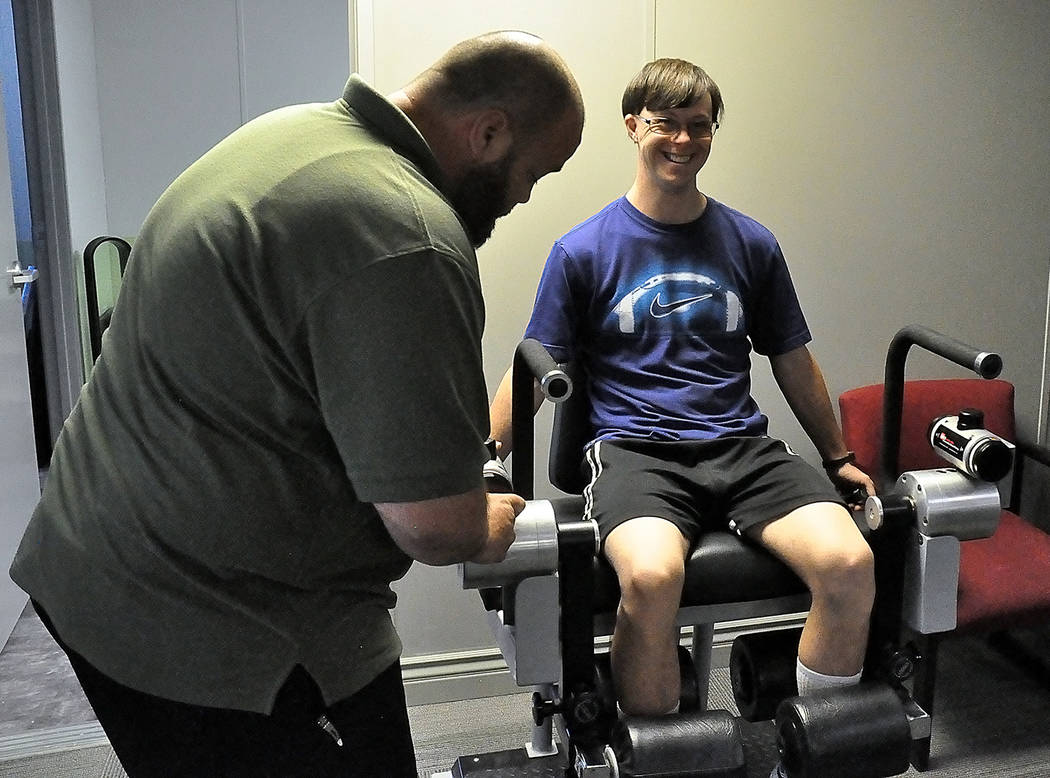 Horace Langford Jr./Pahrump Valley Times Billy Klem, shown working with Chandy Christensen of Advanced Spine and Posture in Pahrump, will compete in the running long jump, 100 meters and 200 meter ...