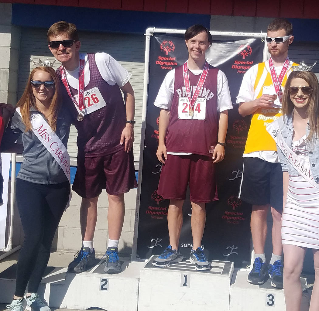 Teresa Klem/Special to the Pahrump Valley Times Billy Klem of Pahrump on the medal stand after winning a gold medal in the running long jump at the Special Olympics Nevada Summer Games in early Ju ...