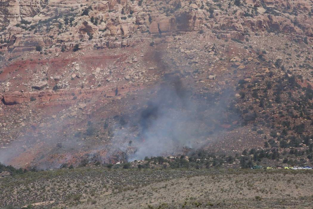 Bizuayehu Tesfaye/Las Vegas Review-Journal Smoke from a wildfire is seen at the Pine Creek trail, off the 13-mile scenic loop of the Red Rock National Conservation Area on Friday, June 22, 2018, ...