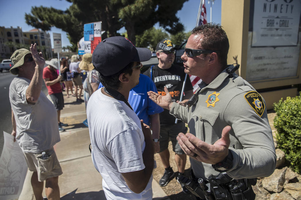 Protesters clash with Metro outside Suncoast hotel-casino ahead of President Donald Trump's appearance on Saturday, June 23, 2018, in Las Vegas. Benjamin Hager Las Vegas Review-Journal @benjaminhphoto