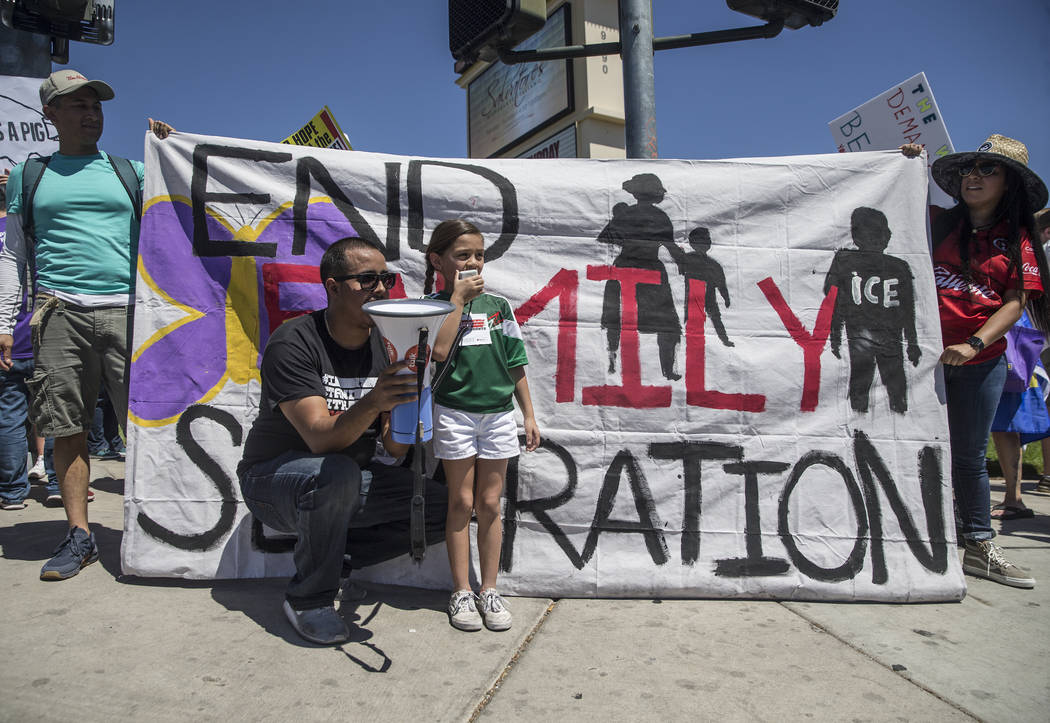 Jiulianna Levine, middle, protests outside Suncoast hotel-casino ahead of President Donald Trump's appearance on Saturday, June 23, 2018, in Las Vegas. Benjamin Hager Las Vegas Review-Journal @ben ...