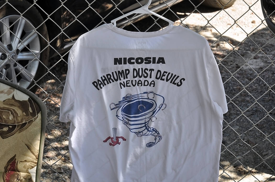 Horace Langford Jr./Pahrump Valley Times The logo of the Pahrump Dust Devils is seen on the back of Mike Nicosia's shirt hanging on a fence Wednesday at Petrack Park.