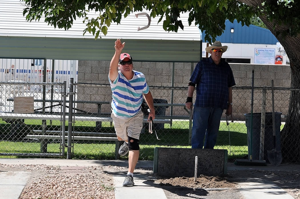 Horace Langford Jr./Pahrump Valley Times Craig Jahnke works on his pitching form as Dennis Anderson watches Wednesday at Petrack Park in Pahrump.