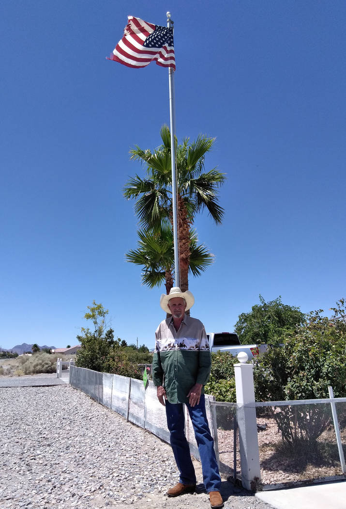 Selwyn Harris/Pahrump Valley Times Local resident Sam Davis, A U.S. Navy Veteran displays the American flag at his South Mt. Charleston property to honor those who have fought and died for the sym ...
