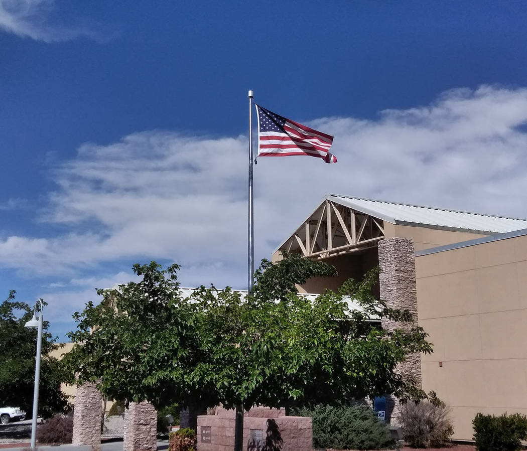 Selwyn Harris/Pahrump Valley Times According to the United States Flag Code, it is the universal custom to display the flag only from sunrise to sunset on buildings and on stationary flagstaffs in ...