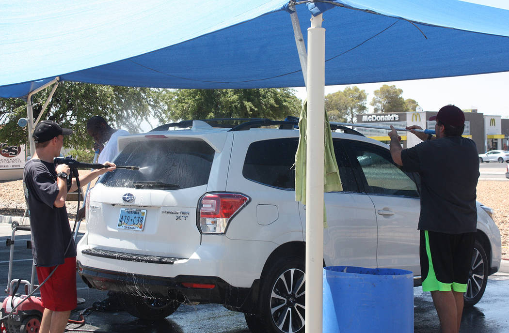 Robin Hebrock/Pahrump Valley Times Patrons were able to drive away in sparkling clean vehicles after visiting the Car Studio donation car wash fundraiser, held June 23 and 24. The proceeds of the ...