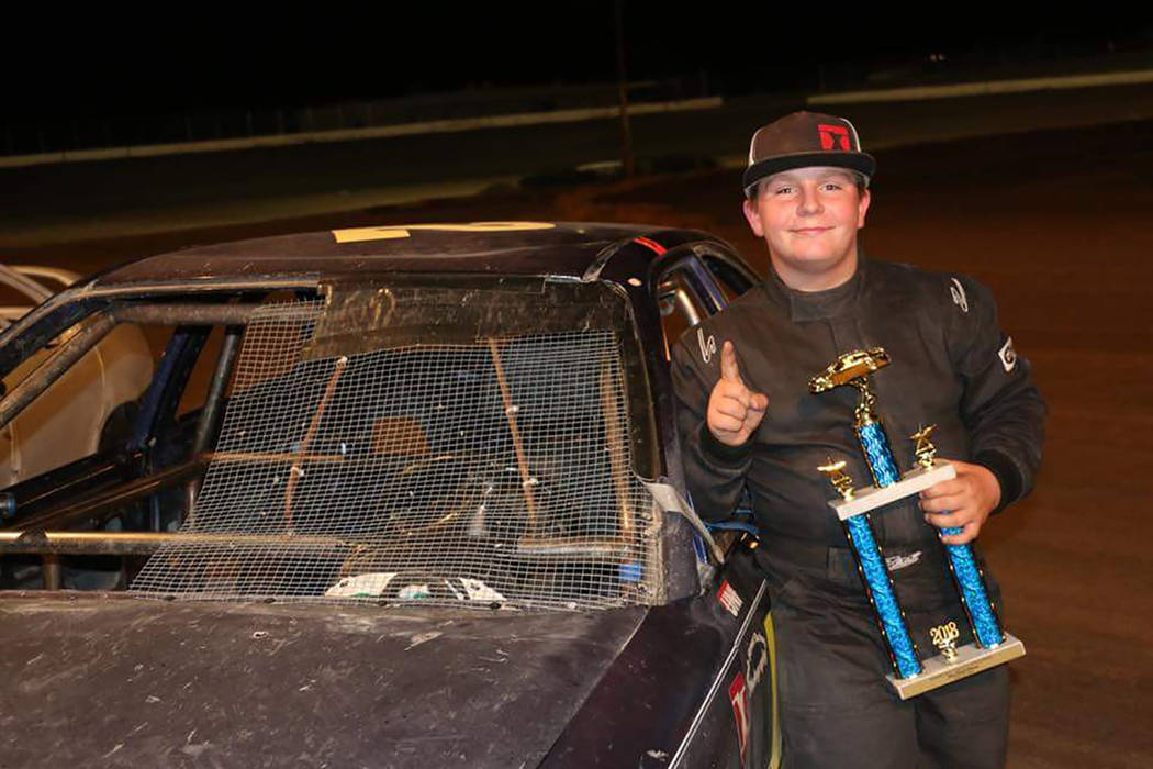 Robert Pearson/Special to the Pahrump Valley Times R.J. Smotherman in victory lane after winning the Mini Stock feature event Saturday night at Pahrump Valley Speedway.