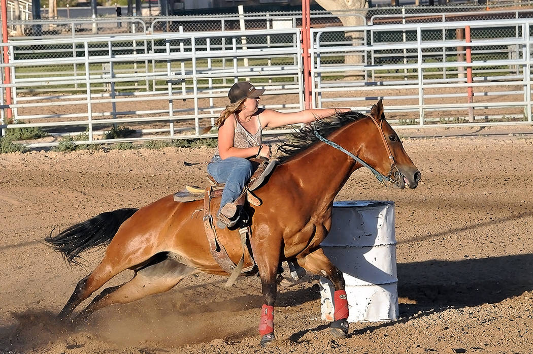 Horace Langford Jr./Pahrump Valley Times Felicity Buesig competes in barrel racing during the Pahrump Valley Rough Riders show June 16 at McCullough Arena in Pahrump.