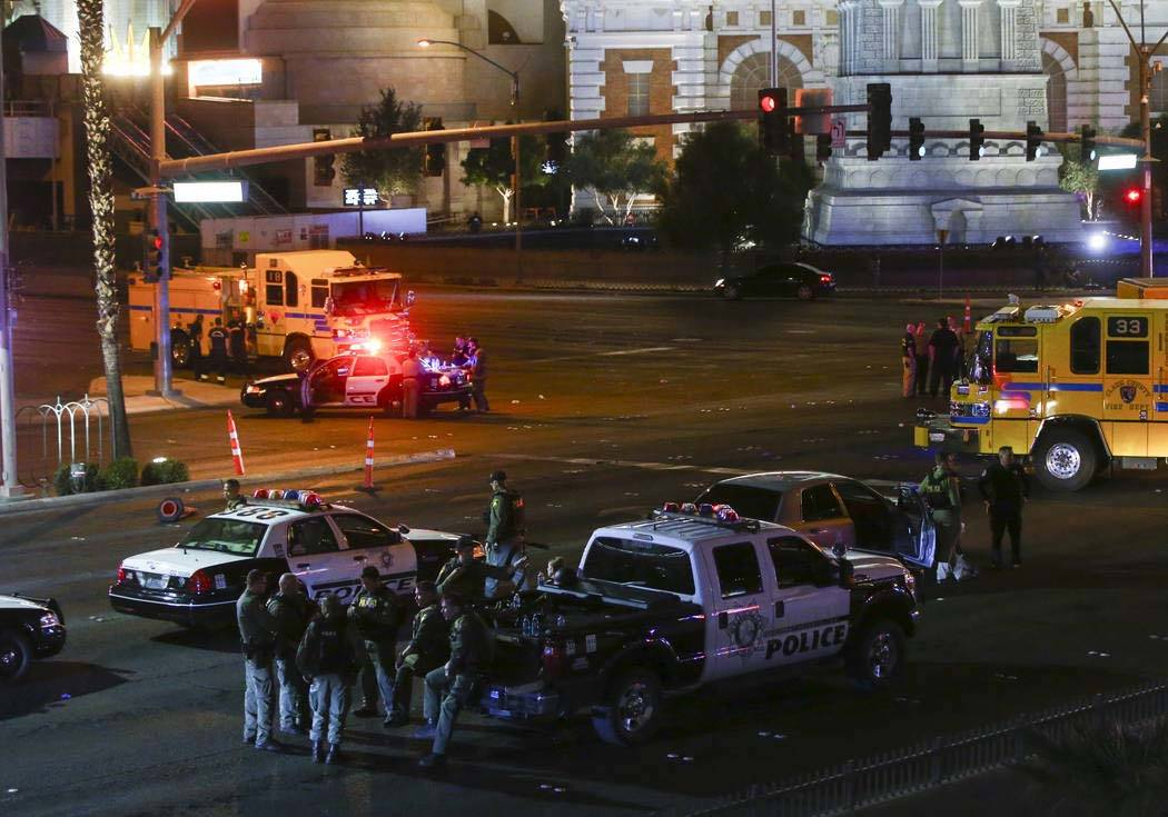 Chase Stevens/Las Vegas Review-Journal Las Vegas police gather in the early morning hours on Monday, Oct. 2, 2017, following the Route 91 Harvest festival shooting that left 58 dead on the Las Ve ...