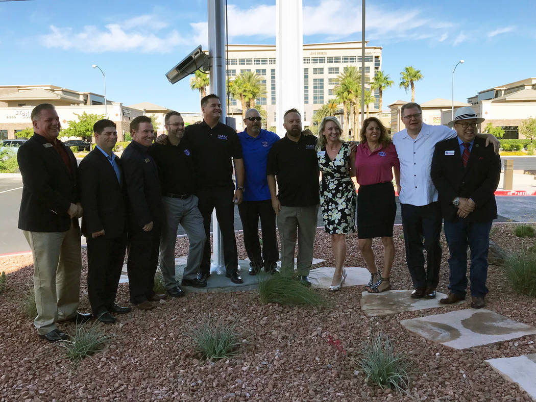 Jeffrey Meehan/Pahrump Valley Times Two Southern Nevada real estate organizations gathered for an inaugural flag raising at the new headquarters of the Greater Las Vegas Association of Realtors at ...