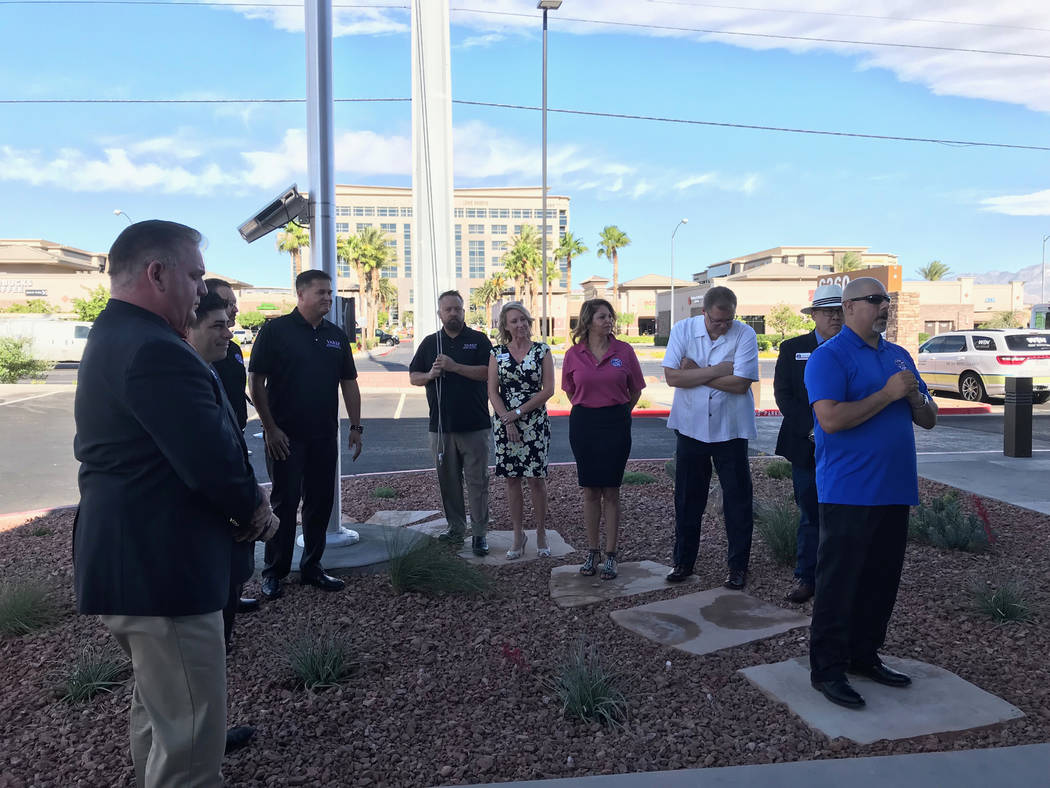 Jeffrey Meehan/Pahrump Valley Times Ernie Gonzales, president of the Veterans Assocation of Real Estate Professionals in Las Vegas, (front-right) led the raising of the flag at GLVAR's South Rai ...