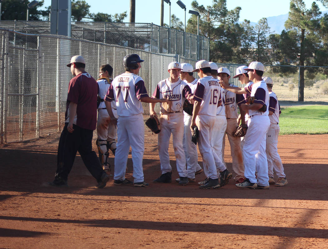 Tom Rysinski/Pahrump Valley Times Pahrump Trojans Gold players congratulate Roman Roberts on another scoreless inning during the Trojans' 7-1 victory over the Summerlin Panthers Green in a Connie ...