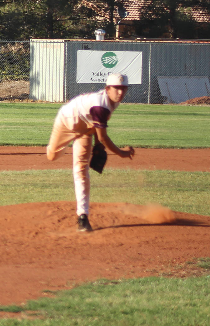 Tom Rysinski/Pahrump Valley Times Roman Roberts delivers during the Pahrump Trojans Gold's 7-1 victory in the first game of a Connie Mack 14U National doubleheader Saturday night at Ian Deutch Mem ...