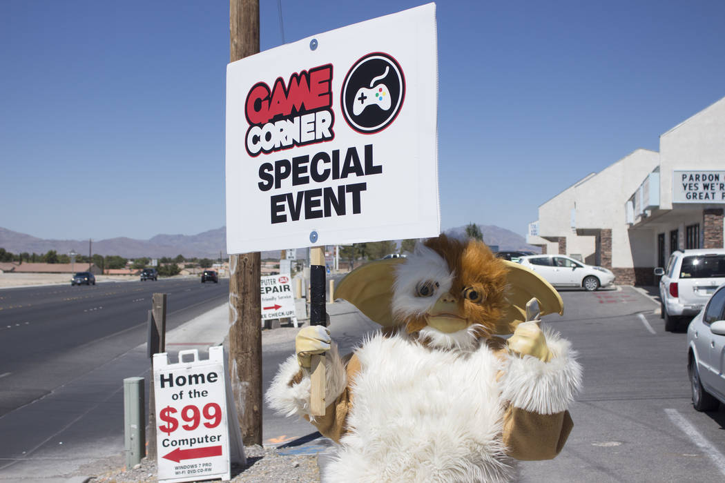 Jeffrey Meehan/Pahrump Valley Times Game Corner, which carries hundreds of video game titles, game systems and other things such as collectibles, had a few friends visits during a grand opening ce ...