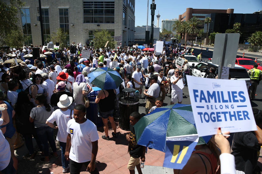 People participate during a rally against the separation of immigrant families outside of the Lloyd George U.S. Courthouse in Las Vegas, Saturday, June 30, 2018. Erik Verduzco Las Vegas Review-Jou ...