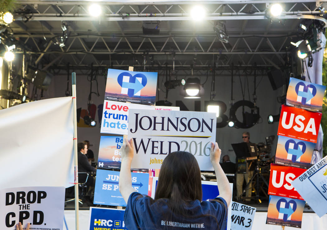 Miranda Alam/Las Vegas Review-Journal A supporter of 2016 Libertarian presidential candidate Gary Johnson holds up a sign in front of the MSNBC stage ahead of the third presidential debate at UNL ...