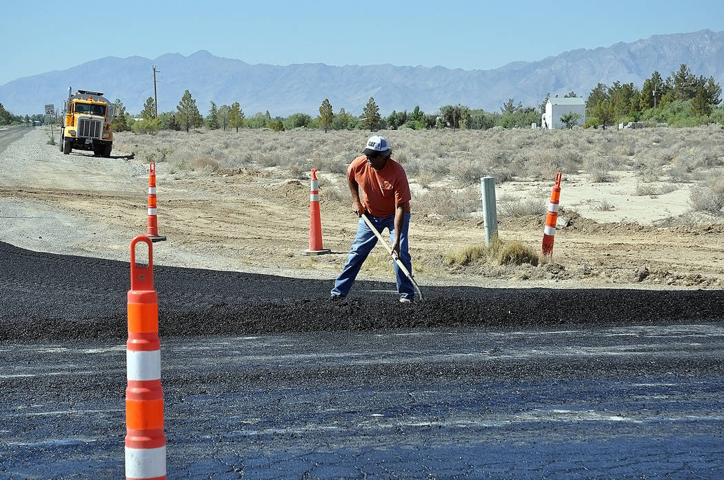 Horace Langford Jr./Pahrump Valley Times A worker is shown on the project in Pahrump earlier this week. Motorists were advised to use caution.