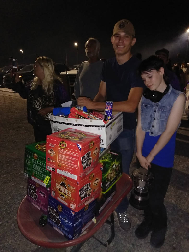 Selwyn Harris/Pahrump Valley Times A wheelbarrow was required for two local residents to bring their cache to the shooters site. Officials shuttled revelers to different sections of the southend l ...