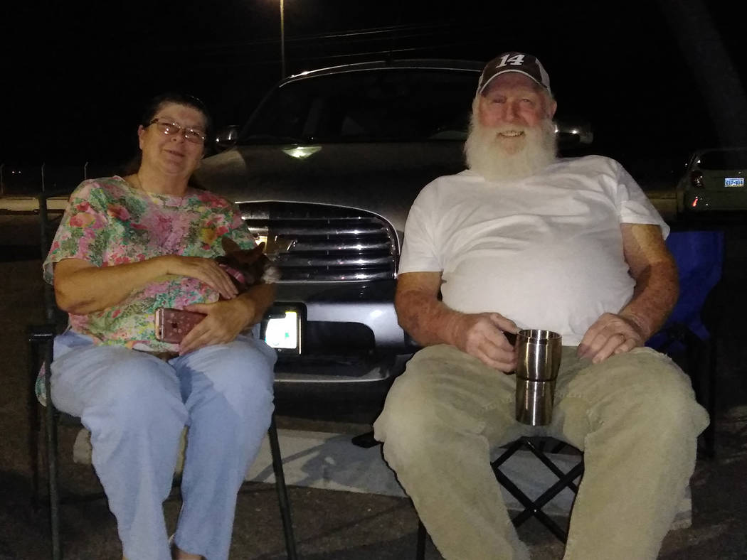Selwyn Harris/Pahrump Valley Times Pahrump residents Melinda and Tom Mangan opted to just their son and grandchildren light up the evening sky from the parking lot of the fireworks shooters site o ...