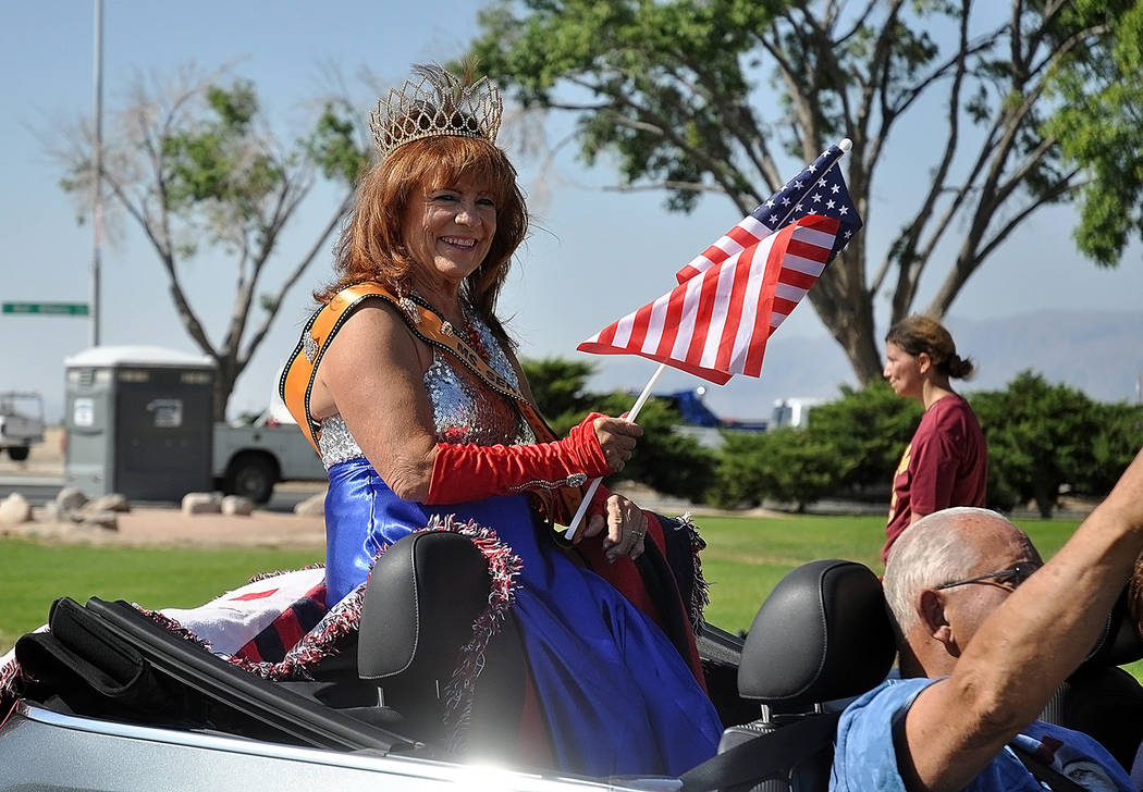 Horace Langford Jr./Pahrump Valley Times Ms. Senior Nye County 2018 Teri Rogers enjoys a leisurely ride around the Calvada Eye during Wednesday's annual July Fourth Parade.